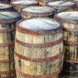 Stack of whisky casks and barrels — Stock Photo