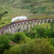 Stock Photo: Steam train on famous Glenfinnviaduct, Scotland