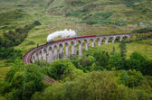 Steam train on a famous Glenfinnan viaduct, Scotland — Stock Photo