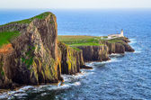 View of Neist Point lighthouse and rocky ocean coastline, Scotla — Stock Photo