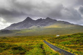 Cuillin Hills mountains with lonely house and road, Scotland — Stock Photo