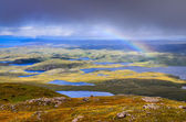 Scenic view of beautiful lakes, clouds and rainbow in Inverpolly — Стоковое фото