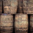 Stock Photo: Stacked old whisky barrels
