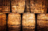 Stacked whisky barrels in vintage style — Stock Photo