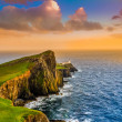 Colorful ocean coast sunset at Neist point lighthouse, Scotland — Stock Photo #36126373