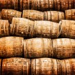 Stock Photo: Stacked pile of old vintage whisky and wine wooden barrels