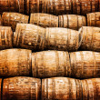 Stacked pile of old vintage whisky and wine wooden barrels — Stock Photo