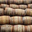Stock Photo: Stacked pile of old whisky and wine wooden barrels