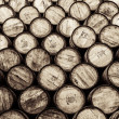 Detail monochrome view of stacked wine and whisky wooden barrels — Stock Photo