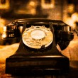 Detail view of old vintage dial telephone on the table  — Stock Photo