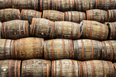 Stacked pile of old whisky and wine wooden barrels — 图库照片