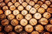 Detail view of stacked whisky and wine wooden barrels — Stock Photo