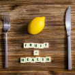 Silverware and lemon set on table with healthy sign — Stockfoto