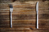 Knife and fork set on a wooden table — Stock Photo