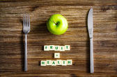 Silverware and apple set on table with healthy sign — Stock Photo