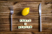 Silverware and lemon set on table with healthy sign — Stock Photo