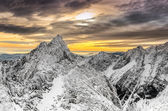 Scenic view of winter mountains and colorful sunset — Stock Photo
