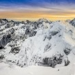 Stock Photo: Panoramic view of winter mountains at colorful sunset