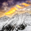 Winter mountains with dramatic colorful sky at sunset — Stock Photo