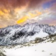 Stock Photo: Panoramic view of white winter mountains after colorful sunset