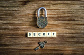 Old vintage padlock and key with secret sign — Stock Photo