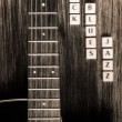 Stock Photo: Detail of guitar and signs rock blues jazz in vintage style