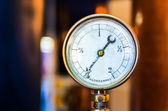 Detail of pressure manometer on nice bokeh background — Stock Photo