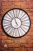 Old vintage clock on textured brick wall — Stock Photo