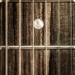 Stock Photo: Detail close-up view of guitar strings and frets