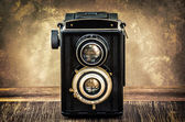 Old fashioned antique camera in vintage style — Stock Photo