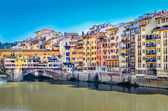 View of colorful houses and Ponte Vecchio bridge in Florence — Stock Photo