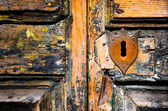 Vintage key hole on weathered wooden door — Stock Photo