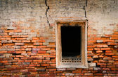 Detail of old weathered brick wall and window — Stock Photo