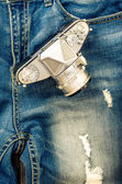 Close-up detail of vintage jeans with classic camera — Stock Photo