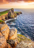 Vertical view of Neist Point lighthouse with rocks foreground, S — Stock Photo