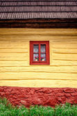 Detail of colorful window on old traditional wooden house — Stock Photo