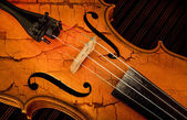 Detail of violin in filtered style as cracked paint — Stock Photo
