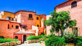 Beautiful colorful houses with nice garden in Sardinia — Stock Photo