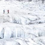 Two people trekking on ice Vatnajokull glacier — Stock Photo #51541659