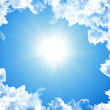 Sun in bright blue sky - Stock Photo