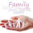 Paper family in hands - Stock fotografie