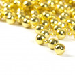 Background made of a brilliant celebratory beads of golden color - Photo