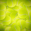 Lots of vibrant tennis balls - Stock Photo