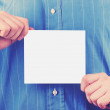 Closeup of businessman's hand holding up card - Stock fotografie