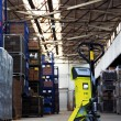 Pallet Jack In The Industrial Hall - Stock Photo