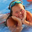 Lillte Girl in the pool — Stock Photo