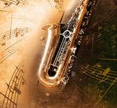 Starý saxofon špinavé zázemí — Stock fotografie