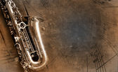 Old Saxophone with dirty background — Zdjęcie stockowe