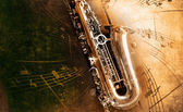 Alt saxophon mit schmutzigen hintergrund — Stockfoto
