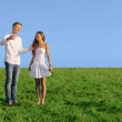 Young couple on summer field — Stock Photo